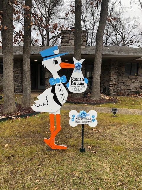 Blue Stork with Dog Bone Sign : Stork Rental in NW Oklahoma City, The Village, Nichols Hills, Edmond, Yukon, Piedmont, Bethany, Arcadia